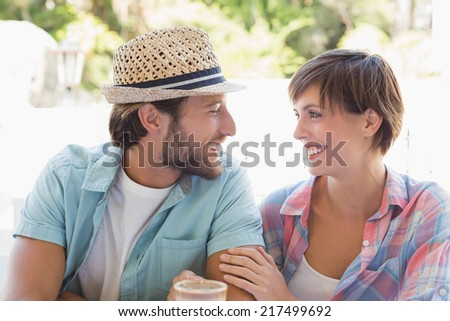 Happy couple enjoying coffee together outside at the coffee shop - stock photo