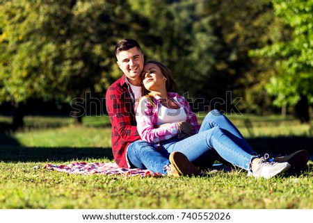 Happy couple enjoying in a park