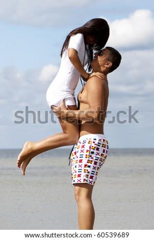Happy couple enjoying vacations - stock photo