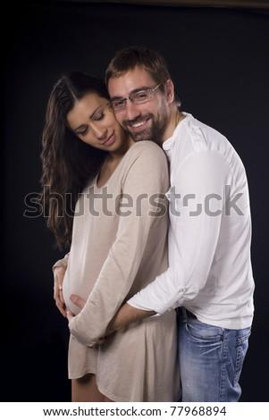 Happy couple expecting baby - stock photo