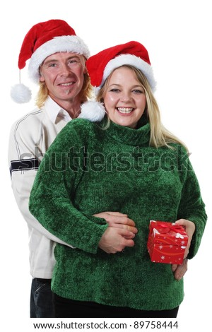 Happy Couple gift giving for Christmas - stock photo
