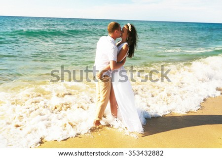 happy couple happy near the ocean kissing