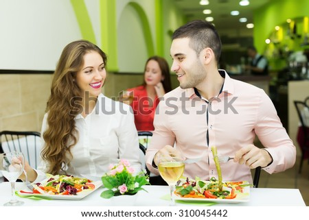happy couple having a dinner at the restaurant. Focus on  man - stock photo