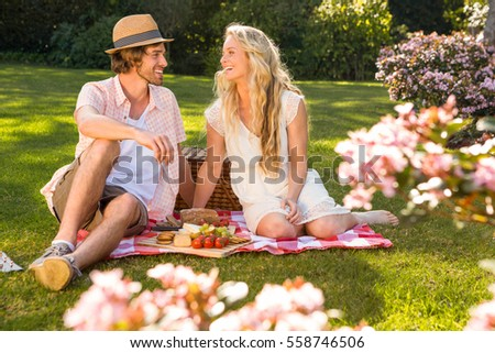 Happy couple having a picnic in the garden