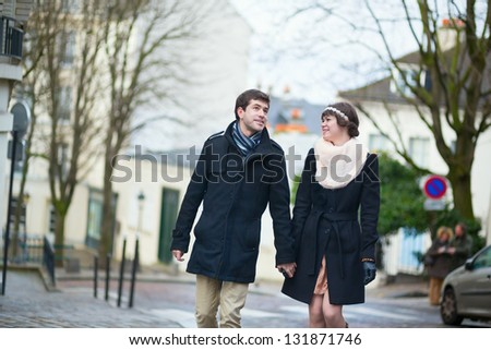 Happy couple having a walk in Paris
