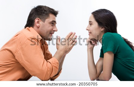 Happy couple having conversation face to face and looking at each other - stock photo