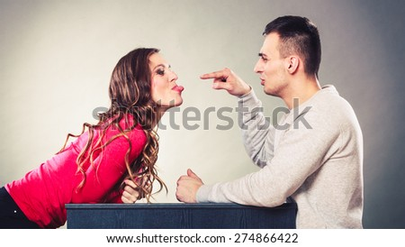 Happy couple having fun and fooling around. Joyful man and woman have nice time. Good relationship. - stock photo