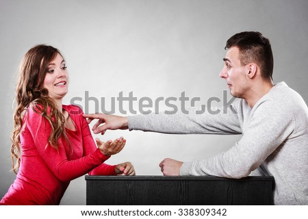 Happy couple having fun and fooling around. Joyful man and woman have nice time. Guy touching girl. Good relationship.