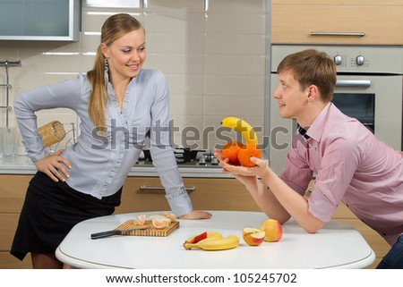 Happy Couple having fun on a kitchen.Dieting concept.Healthy eating