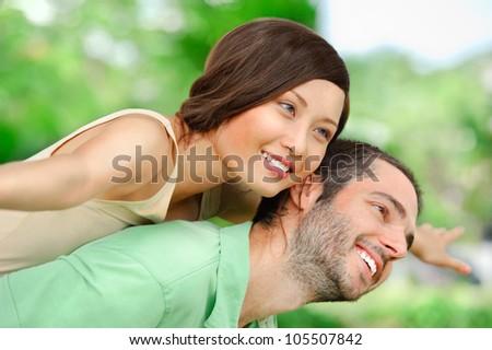 Happy couple having fun outside - stock photo