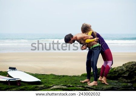 Happy couple having fun together during summer holidays vacation - stock photo