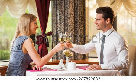 Happy couple having great time at the restaurant - stock photo
