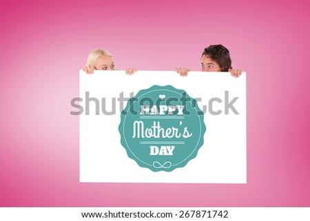 Happy couple hiding against pink vignette - stock photo