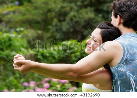 happy couple holding each other by hands - stock photo