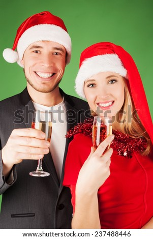 Happy couple holding glasses of champagne - stock photo