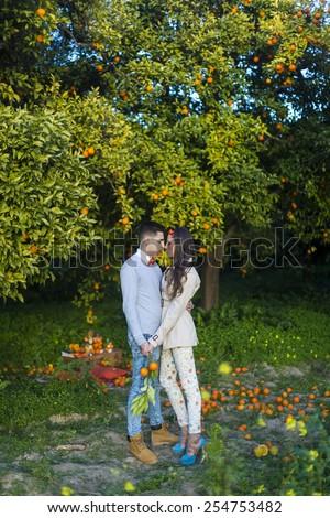 Happy couple  in a orange garden - Romantic date outdoors - stock photo