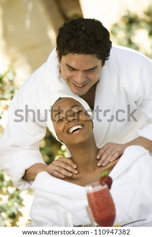 Happy couple in a spa - stock photo