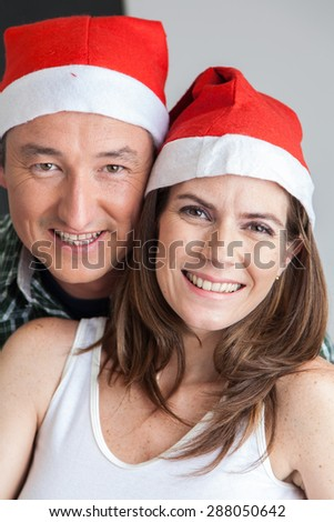 Happy couple in christmas hats
