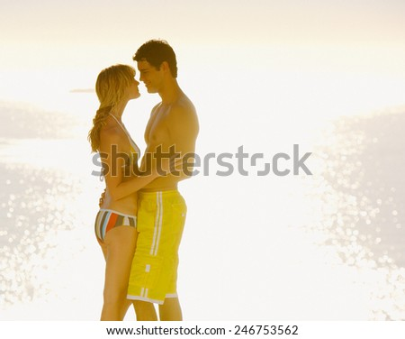 Happy couple in hotel pool - stock photo
