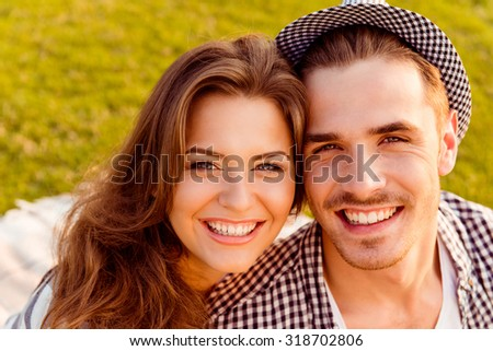 happy couple in love at a picnic - stock photo