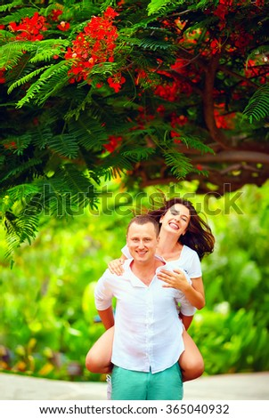 happy couple in love having fun in spring garden - stock photo