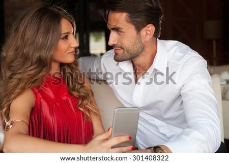 happy couple in love in the restaurant - stock photo
