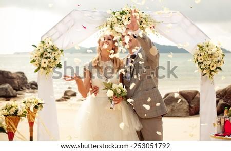 Happy Couple in love on wedding ceremony seaside tropical beach thailand phuket EUROPIAN STYLE arch - stock photo