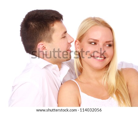Happy couple in love on white background. Man whisper a compliment. - stock photo