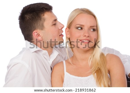 Happy couple in love on white background. Man whisper a compliment - stock photo