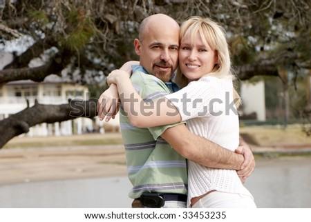 Happy couple in park - stock photo
