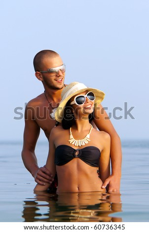 Happy couple in sea - stock photo