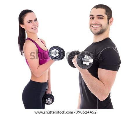 happy couple in sportswear doing exercises with dumbbells isolated on white background - stock photo