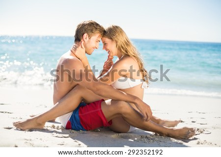 Happy couple in swimsuit at the beach - stock photo