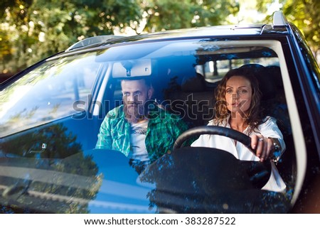 Happy couple in the car - stock photo