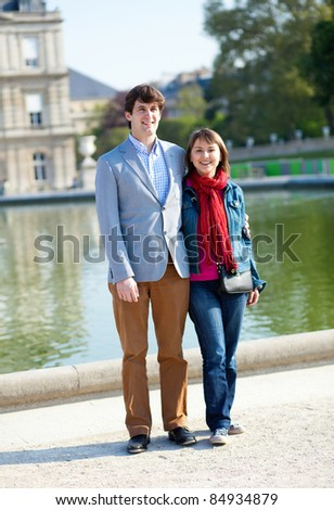 Happy couple in the Luxembourg garden in Paris