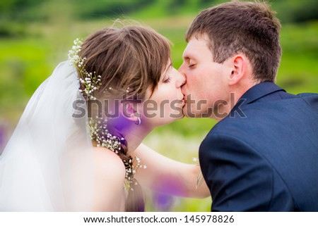happy couple in the nature. the bride and groom. kiss. wedding walk