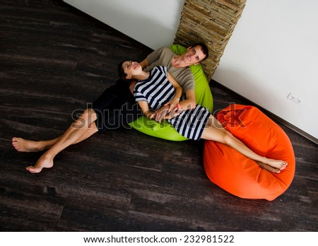 Happy couple in their new home - stock photo