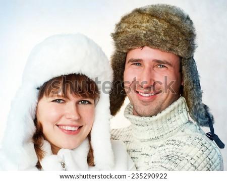 happy couple in warm fur hats.  winter season. - stock photo