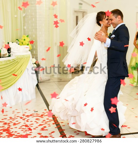 happy couple is dancing on the  background restaurant - stock photo