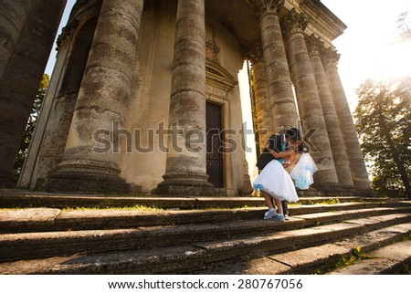 happy couple is kissing on background old castle - stock photo