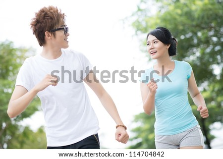 Happy couple jogging on a lovely summer day - stock photo
