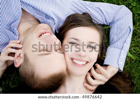 Happy couple laying on grass