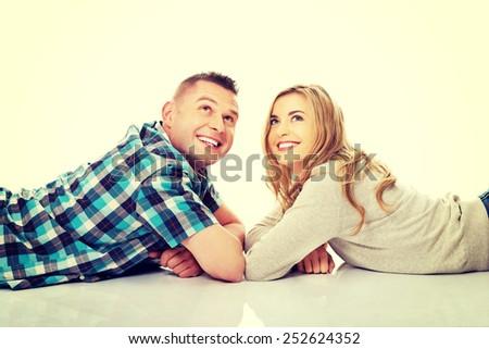 Happy couple look on empty copy space - stock photo