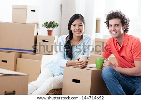 Happy couple moving into a new apartment. - stock photo