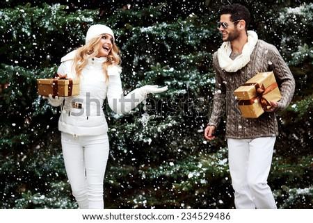 Happy couple near a Christmas tree. Christmas Eve. - stock photo