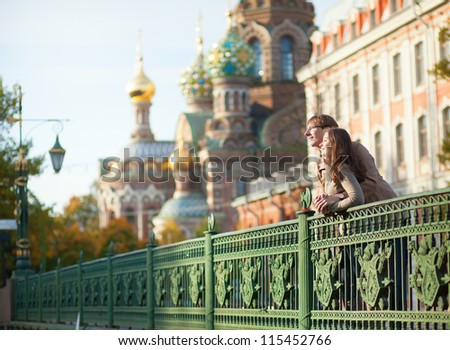 Happy couple near the Church of the Savior on Blood in Saint-Petersburg, Russia - stock photo