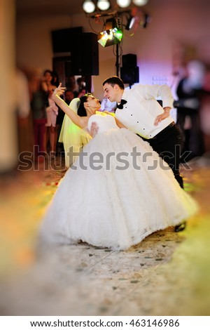 Happy couple of newlyweds dance, groom and bride dancing in restaurant