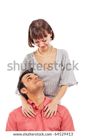 Happy couple of young adults looking at each other; isolated on white background - stock photo