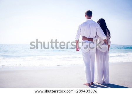Happy couple on the beach on a sunny day