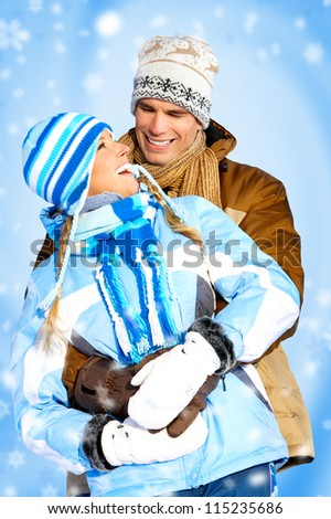 Happy couple on the winter background. - stock photo